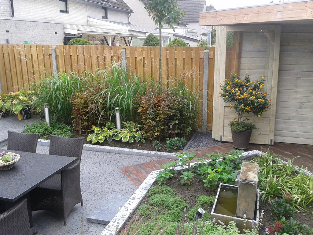 Tuin met houten overkapping JVM Tuinen